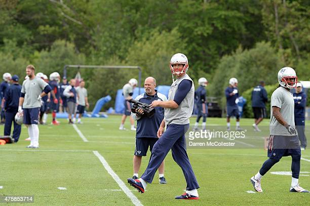 Tom Brady of the New England Patriots works out during organized team activities at Gillette Stadium on June 4 2015 in Foxborough Massachusetts