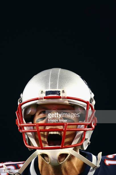 Tom Brady of the New England Patriots yells as he runs onto the field before the game against the Kansas City Chiefs at Gillette Stadium on September...