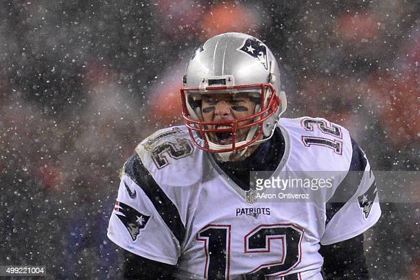 Tom Brady of the New England Patriots yells from the line of scrimmage as the Patriots are forced to take a time out in the third quarter The Broncos...