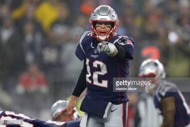 Tom Brady of the New England Patriots yells to teammates on the field during the the AFC Wild Card Playoff game against the Tennessee Titans at...
