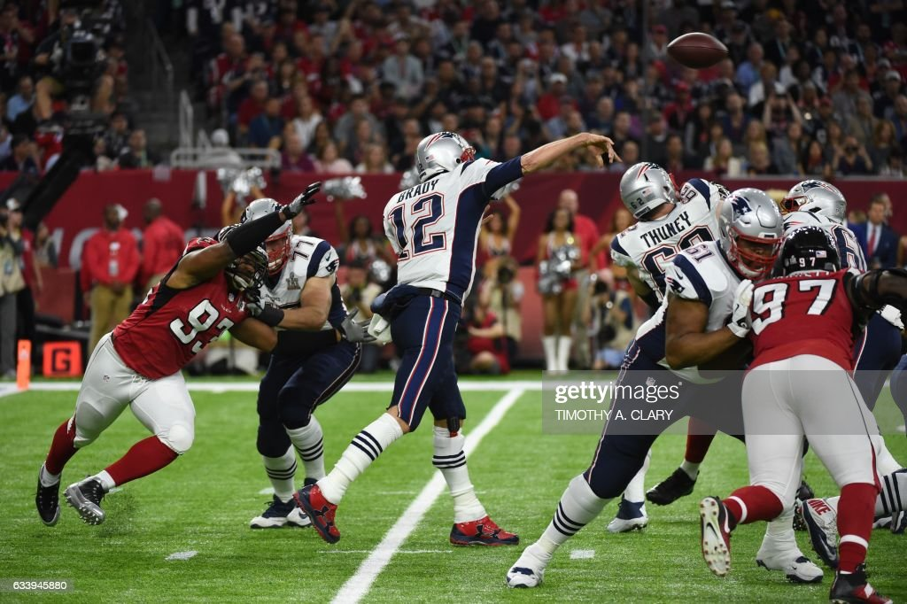 Tom Brady (12) of the Patriots passes during Super Bowl LI between the New England Patriots and the Atlanta Falcons at NGR Stadium in Houston, Texas, on February 5, 2017. / AFP PHOTO / Timothy A. CLARY