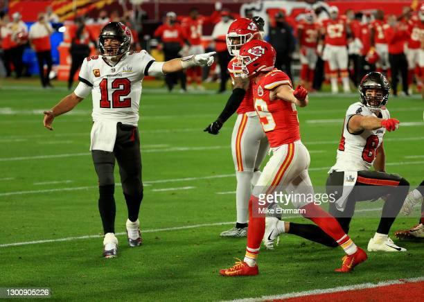 Tom Brady of the Tampa Bay Buccaneers and Daniel Sorensen of the Kansas City Chiefs react after a goal line stand in the second quarter during Super...