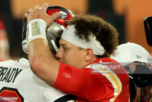 Tom Brady of the Tampa Bay Buccaneers and Patrick Mahomes of the Kansas City Chiefs speak after Super Bowl LV at Raymond James Stadium on February...