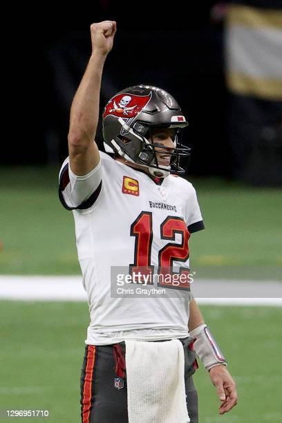 Tom Brady of the Tampa Bay Buccaneers celebrates a first down against the New Orleans Saints late in the fourth quarter in the NFC Divisional Playoff...