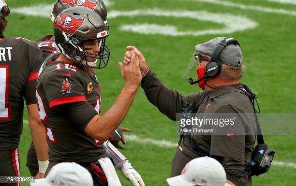 Tom Brady of the Tampa Bay Buccaneers celebrates a touchdown with head coach Bruce Arians of the Tampa Bay Buccaneers during a game against the...