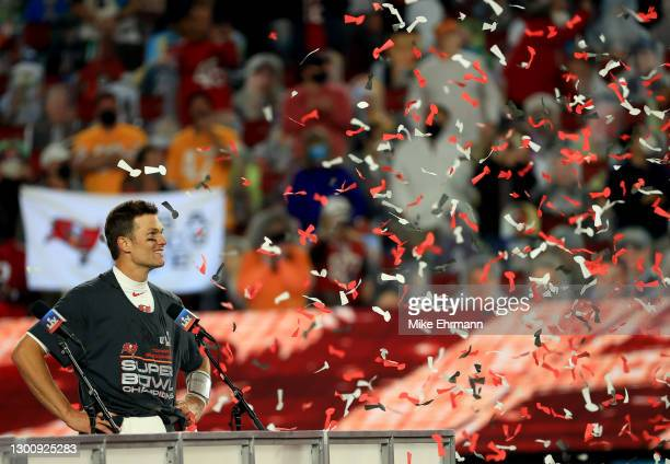 Tom Brady of the Tampa Bay Buccaneers celebrates as confetti falls after defeating the Kansas City Chiefs in Super Bowl LV at Raymond James Stadium...