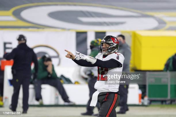 Tom Brady of the Tampa Bay Buccaneers celebrates in the final seconds of their 31 to 26 win over the Green Bay Packers during the NFC Championship...