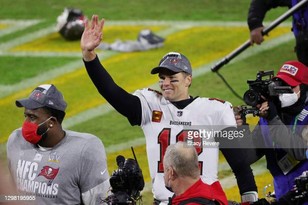 Tom Brady of the Tampa Bay Buccaneers celebrates their 31 to 26 win over the Green Bay Packers during the NFC Championship game at Lambeau Field on...