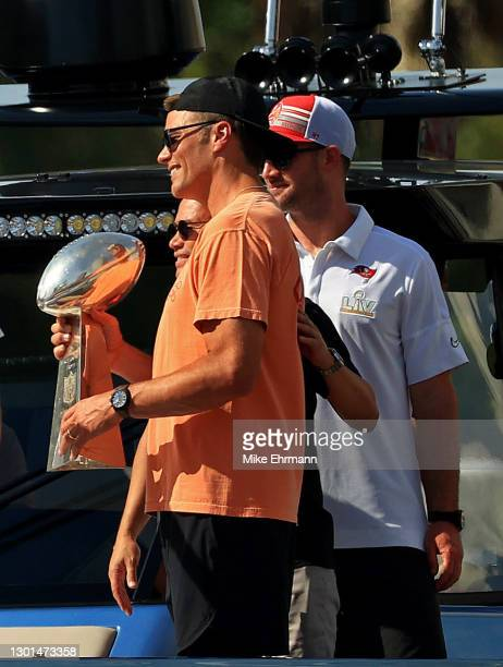 Tom Brady of the Tampa Bay Buccaneers celebrates their Super Bowl LV victory with the Vince Lombardi trophy during a boat parade through the city on...