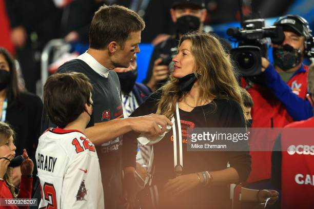 Tom Brady of the Tampa Bay Buccaneers celebrates with Gisele Bundchen after winning Super Bowl LV at Raymond James Stadium on February 07, 2021 in...