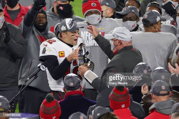 Tom Brady of the Tampa Bay Buccaneers celebrates with head coach Bruce Arians and teammates after their 31 to 26 win over the Green Bay Packers...