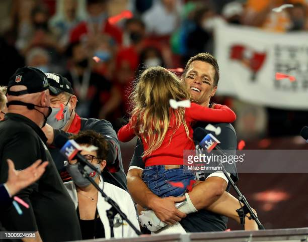 Tom Brady of the Tampa Bay Buccaneers celebrates with his daughter Vivian Brady after defeating the Kansas City Chiefs in Super Bowl LV at Raymond...