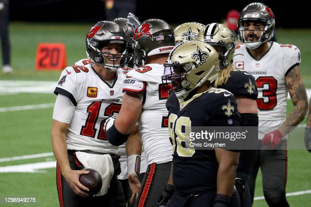 Tom Brady of the Tampa Bay Buccaneers celebrates with his teammates after scoring a touchdown against the New Orleans Saints during the fourth...