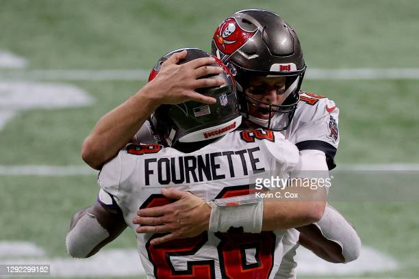 Tom Brady of the Tampa Bay Buccaneers celebrates with Leonard Fournette after a first down against the Atlanta Falcons during the fourth quarter in...