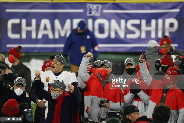 Tom Brady of the Tampa Bay Buccaneers celebrates with teammates after their 31 to 26 win over the Green Bay Packers during the NFC Championship game...