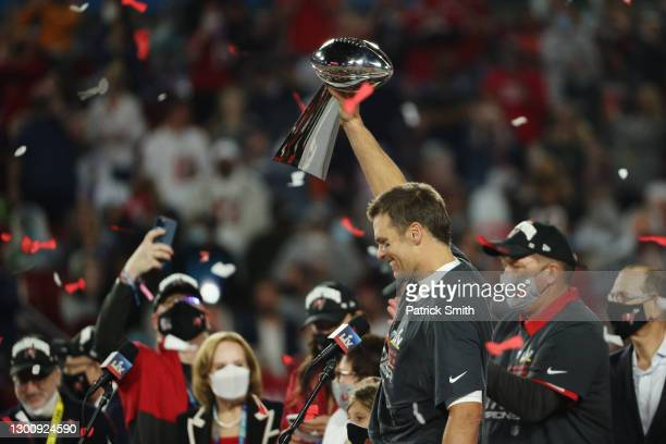 Tom Brady of the Tampa Bay Buccaneers celebrates with the Lombardi Trophy after defeating the Kansas City Chiefs in Super Bowl LV at Raymond James...
