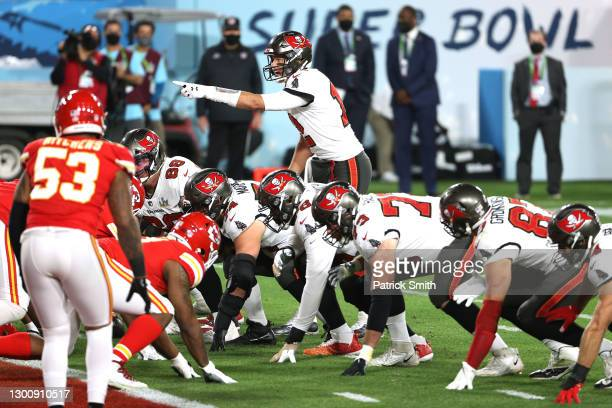 Tom Brady of the Tampa Bay Buccaneers gestures at the line before a play in the second quarter against the Kansas City Chiefs in Super Bowl LV at...