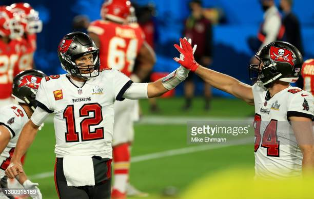 Tom Brady of the Tampa Bay Buccaneers high fives Cameron Brate during the third quarter against the Kansas City Chiefs in Super Bowl LV at Raymond...