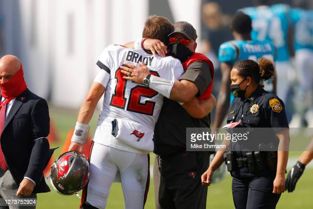 Tom Brady of the Tampa Bay Buccaneers hugs head coach Bruce Arians after defeating the Carolina Panthers 31-17 at Raymond James Stadium on September...