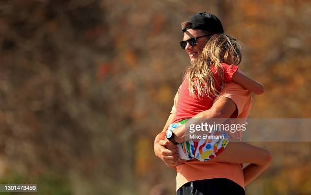 Tom Brady of the Tampa Bay Buccaneers hugs his daughter Vivian celebrating their Super Bowl LV victory during a boat parade through the city on...