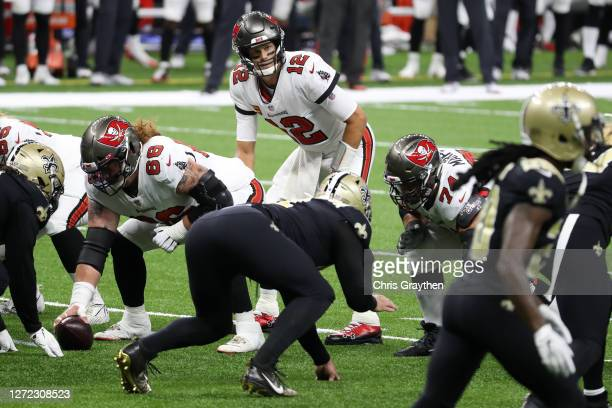 Tom Brady of the Tampa Bay Buccaneers lines up under center during the first quarter against the New Orleans Saints at Mercedes-Benz Superdome on...