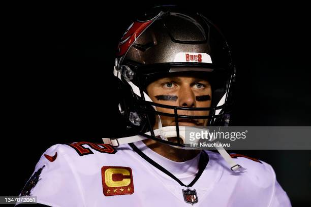 Tom Brady of the Tampa Bay Buccaneers looks on before playing against the Philadelphia Eagles at Lincoln Financial Field on October 14, 2021 in...