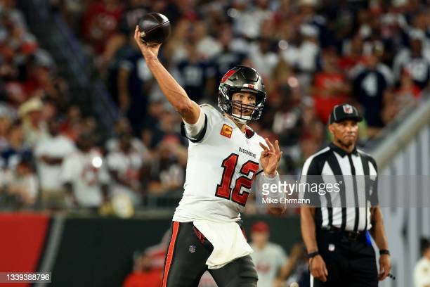 Tom Brady of the Tampa Bay Buccaneers looks to pass against the Dallas Cowboys during the third quarter at Raymond James Stadium on September 09,...