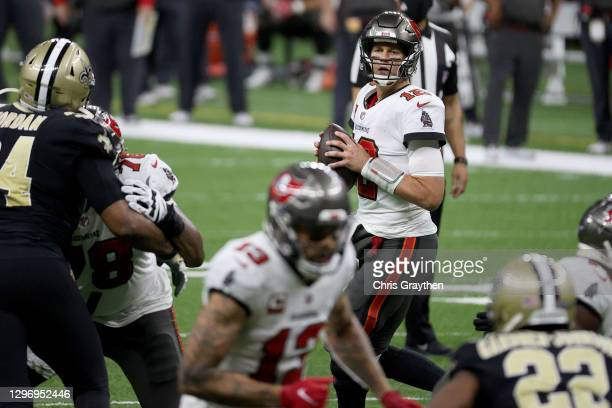 Tom Brady of the Tampa Bay Buccaneers looks to throw a pass against the New Orleans Saints during the fourth quarter in the NFC Divisional Playoff...