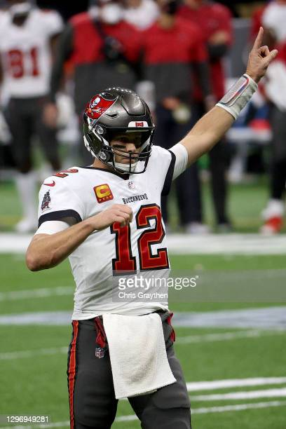 Tom Brady of the Tampa Bay Buccaneers points to the air against the New Orleans Saints during the fourth quarter in the NFC Divisional Playoff game...