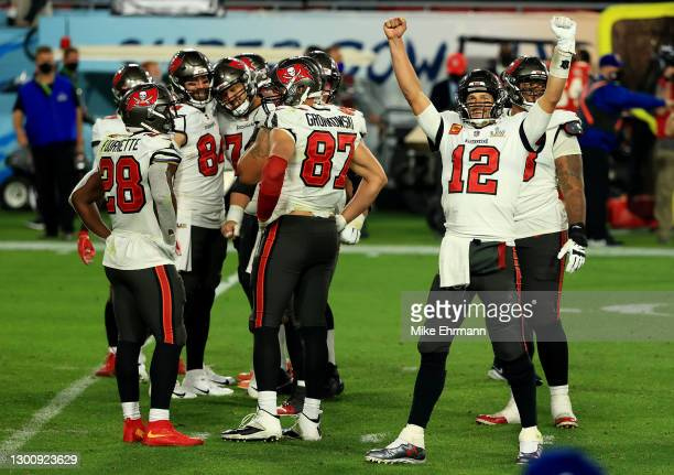 Tom Brady of the Tampa Bay Buccaneers reacts with teammates late in the fourth quarter against the Kansas City Chiefs in Super Bowl LV at Raymond...