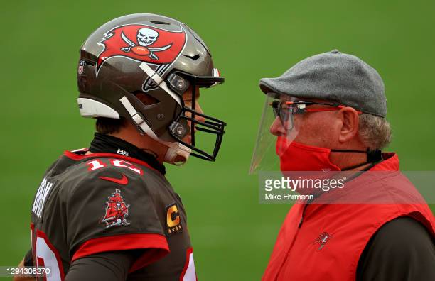 Tom Brady of the Tampa Bay Buccaneers talks with head coach Bruce Arians of the Tampa Bay Buccaneers before a game against the Atlanta Falcons at...