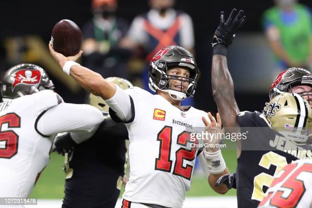 Tom Brady of the Tampa Bay Buccaneers throws against the New Orleans Saints during the third quarter at the Mercedes-Benz Superdome on September 13,...