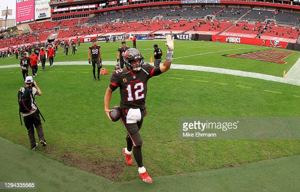 Tom Brady of the Tampa Bay Buccaneers walks off the field after wining a game against the Atlanta Falcons at Raymond James Stadium on January 03,...