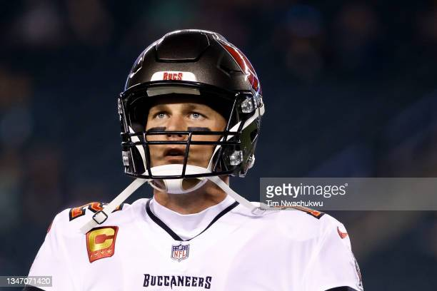 Tom Brady of the Tampa Bay Buccaneers warms up before playing against the Philadelphia Eagles at Lincoln Financial Field on October 14, 2021 in...