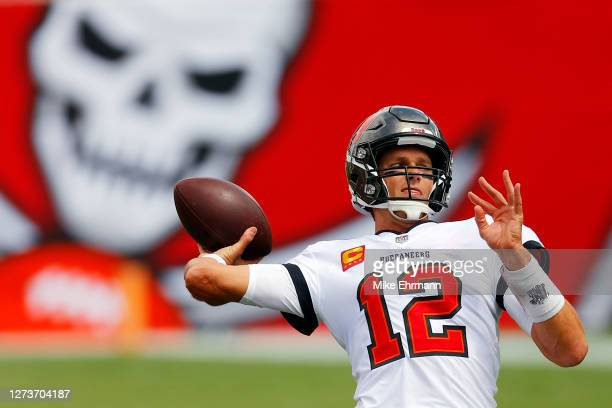 Tom Brady of the Tampa Bay Buccaneers warms up before the game against the Carolina Panthers at Raymond James Stadium on September 20, 2020 in Tampa,...