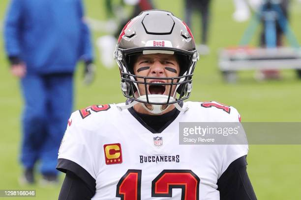 Tom Brady of the Tampa Bay Buccaneers warms up prior to their NFC Championship game against the Green Bay Packers at Lambeau Field on January 24,...