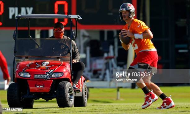 Tom Brady of the Tampa Bay Buccaneers works out with head coach Bruce Arians of the Tampa Bay Buccaneers during training camp at AdventHealth...