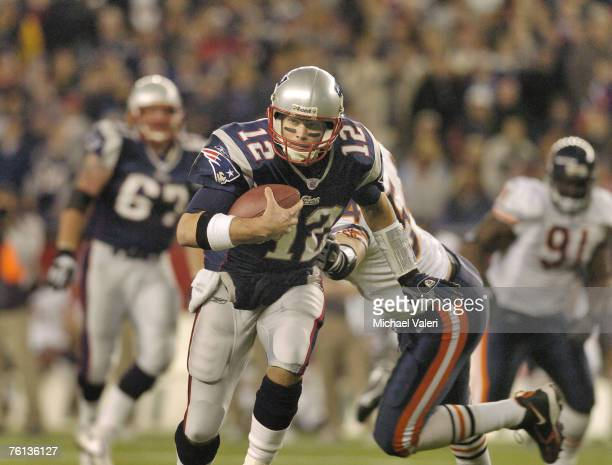 Tom Brady picks up 11 yards on a keeper during the game against the Chicago Bears at Gillette Stadium Foxborough Massachusetts November 26 2006 The...