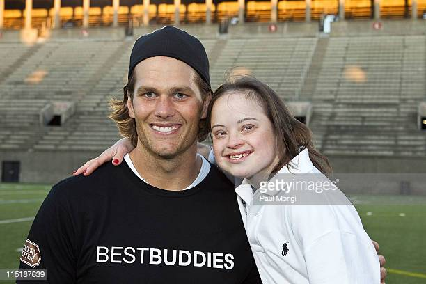 Tom Brady poses for a photo with Best Buddie Katie Meade at the flag football kick off for the 2011 Audi Best Buddies Challenge at Harvard Stadium on...