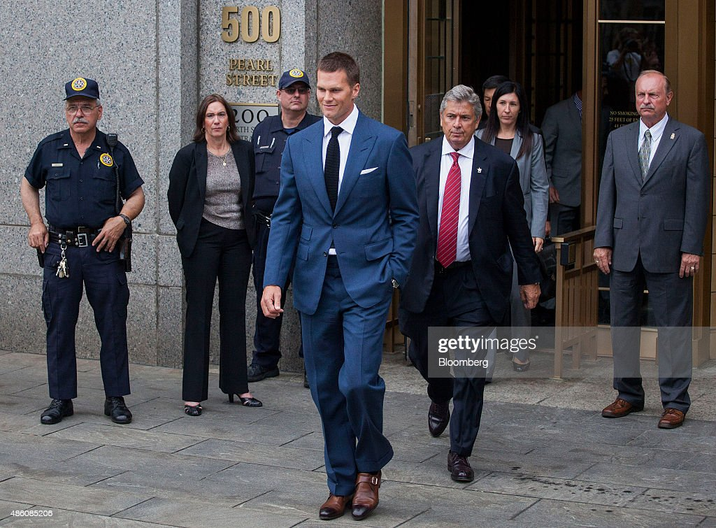 Tom Brady, quarterback for the New England Patriots of the National Football League (NFL), center, exits federal court in New York, U.S., on Monday, Aug. 31, 2015. Brady and NFL Commissioner Roger Goodell will find out this week whether a judge upholds Brady's four-game suspension relating to having used deflated footballs in a playoff game last year. Photographer: Michael Nagle/Bloomberg via Getty Images