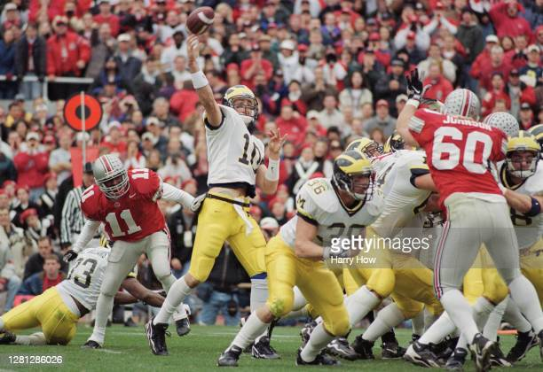 Tom Brady Quarterback for the University of Michigan Wolverines throws a pass downfield during the NCAA Big Ten Conference college football game...