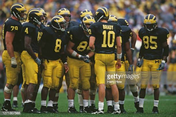 Tom Brady Quarterback for the University of Michigan Wolverines instructs his offensive line in the huddle during the NCAA Division I-A Big 10...