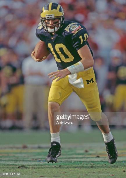 Tom Brady Quarterback for the University of Michigan Wolverines runs the ball downfield during the NCAA Florida Citrus Bowl college football game...
