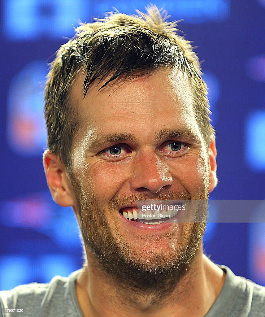 Tom Brady reacts to a reporter's question. The New England Patriots practiced at the practice field at Gillette Stadium.