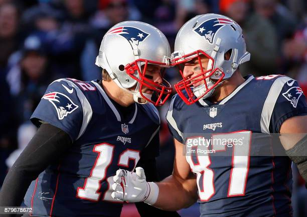 Tom Brady reacts with Rob Gronkowski of the New England Patriots after a touchdown during the third quarter of a game against the Miami Dolphins at...