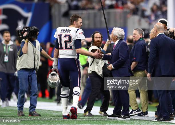 Tom Brady speaks with New England Patriots owner Robert Kraft prior to Super Bowl LIII a the Los Angeles Rams at MercedesBenz Stadium on February 03...
