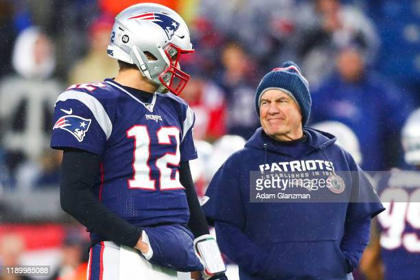 Tom Brady talks to head coach Bill Belichick of the New England Patriots before a game against the Dallas Cowboys at Gillette Stadium on November 24...