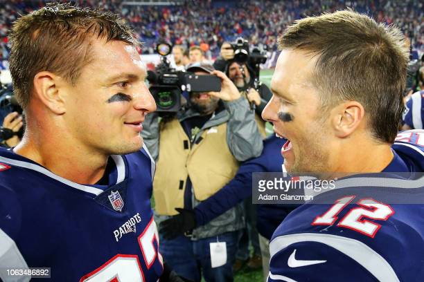Tom Brady talks to Rob Gronkowski of the New England Patriots after a victory over the Kansas City Chiefs at Gillette Stadium on October 14 2018 in...