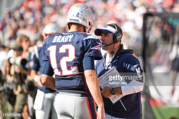 Tom Brady talks with New England Patriots offensive coordinator Josh McDaniels during the fourth quarter against the New York Jets at Gillette...