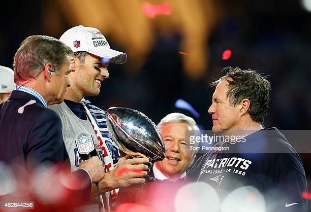 Tom Brady, team owner Robert Kraft, and head coach Bill Belichick of the New England Patriots celebrate with the Vince Lombardi Trophy after...